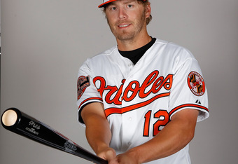 SARASOTA, FL - MARCH 01:  Infielder Mark Reynolds #12 of the Baltimore Orioles poses for a photo during photo day at Ed Smith Stadium on March 1, 2011 in Sarasota, Florida.  (Photo by J. Meric/Getty Images)