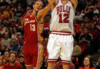 CHICAGO - APRIL 25: Kirk Hinrich #12 of the Chicago Bulls puts up a shot over Delonte West #13 of the Cleveland Cavaliers in Game Four of the Eastern Conference Quarterfinals during the 2010 NBA Playoffs at the United Center on April 25, 2010 in Chicago,