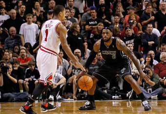 MIAMI, FL - JANUARY 29:  Derrick Rose #1 of the Chicago Bulls is guarded by LeBron James #6 of the Miami Heat during a game at American Airlines Arena on January 29, 2012 in Miami, Florida. NOTE TO USER: User expressly acknowledges and agrees that, by dow