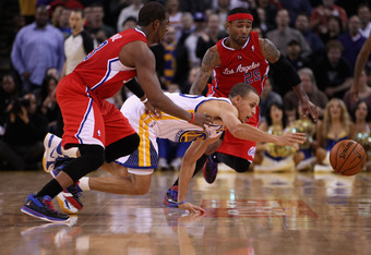 OAKLAND, CA - FEBRUARY 20:  Stephen Curry #30 of the Golden State Warriors and Chris Paul #3 and Mo Williams #25 of the Los Angeles Clippers go for a loose ball at Oracle Arena on February 20, 2012 in Oakland, California.  NOTE TO USER: User expressly ack