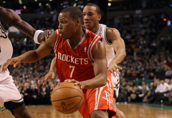 BOSTON, MA - MARCH 06:  Kyle Lowry #7 of the Houston Rockets drives past Avery Bradley #0 of the Boston Celtics on March 6, 2012 at TD Garden in Boston, Massachusetts. The Boston Celtics defeated the Houston Rockets 97-92 in overtime. NOTE TO USER: User e