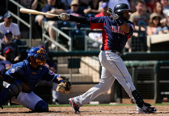 SURPRISE, AZ - MARCH 11:  Carlos Santana #41 of the Cleveland Indians swings the bat against the Texas Rangers during a spring training baseball game at Surprise Stadium on March 11, 2012 in Surprise, Arizona.  (Photo by Kevork Djansezian/Getty Images)