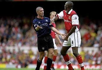 Patrick Vieira, right, has a long, rocky history with Manchester United.