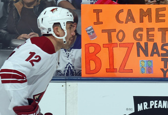 TORONTO, ON - NOVEMBER 15:  A fan displays a poster for one of the NHL's top tweeters Paul Bissonnette #12 of the Phoenix Coyotes during warmups prior to the game against the Toronto Maple Leafs at the Air Canada Centre on November 15, 2011 in Toronto, On