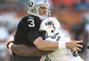 Cameron Wake may be a caged animal, but he just wants a hug.