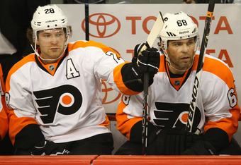 WINNIPEG, MB - FEBRUARY 21: Claude Giroux #28 of the Philadelphia Flyers sits next to Jaromir Jagr #68 during their NHL game against the Winnipeg Jets at MTS Centre on February 21, 2012 in Winnipeg, Manitoba, Canada. (Photo by Tom Szczerbowski/Getty Image