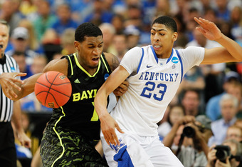 ATLANTA, GA - MARCH 25:  Anthony Davis #23 of the Kentucky Wildcats and Perry Jones III #1 of the Baylor Bears vie for posession during the 2012 NCAA Men's Basketball South Regional Final at the Georgia Dome on March 25, 2012 in Atlanta, Georgia.  (Photo