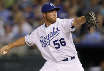 KANSAS CITY, MO - AUGUST 03: Greg Holland #56 relief pitcher of the Kansas City Royals throws in the eighth inning against the Baltimore Orioles at Kauffman Stadium on August 3, 2011 in Kansas City, Missouri. (Photo by Ed Zurga/Getty Images)