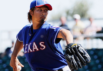 GOODYEAR, AZ - MARCH 13:  Yu Darvish #11 of the Texas Rangers throws a pitch in the second inning of a spring training baseball game against the Cleveland Indians on March 13, 2012 in Goodyear, Arizona.  (Photo by Kevork Djansezian/Getty Images)
