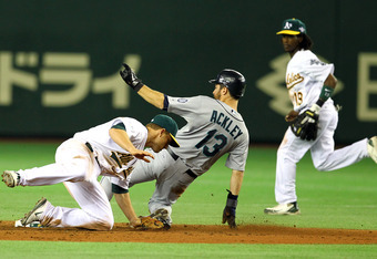 TOKYO, JAPAN - MARCH 28:  Dustin Ackley #13 of the Seattle Mariners steals a base against the Oakland Athletics at Tokyo Dome on March 28, 2012 in Tokyo, Japan. (Photo by Koji Watanabe/Getty Images)