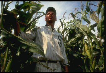 DYERSVILLE, IA - AUGUST 25: A 'ghost player' in a vintage Chicago White Sox baseball uniform emerges from a cornfield as he re-enacts the scene at the baseball field created for the motion picture 'Field of Dreams' on August 25, 1991 in Dyersville, Iowa.