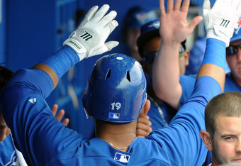 DUNEDIN, FL - MARCH 24: Outfielder Jose Bautista #19 of the Toronto Blue Jays celebrates after a double against the Atlanta Braves March 24, 2012 at Florida Auto Exchange Stadium in Dunedin, Florida. (Photo by Al Messerschmidt/Getty Images)
