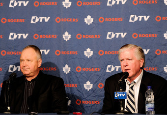 MONTREAL, CANADA - MARCH 3:  Toronto Maple Leafs General Manger Brian Burke (R) introduces new head coach Randy Carlyle at a press conference at the Bell Centre on March 3, 2012 in Montreal, Quebec, Canada.  (Photo by Richard Wolowicz/Getty Images)