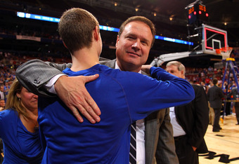 ST LOUIS, MO - MARCH 25:  Head coach Bill Self of the Kansas Jayhawks celebrates with his son TYler after Kansas won 80-67 against the North Carolina Tar Heels during the 2012 NCAA Men's Basketball Midwest Regional Final at Edward Jones Dome on March 25,