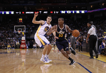 OAKLAND, CA - JANUARY 07:  Alec Burks #10 of the Utah Jazz drives on Klay Thompson #11 of the Golden State Warriors at Oracle Arena on January 7, 2012 in Oakland, California.  NOTE TO USER: User expressly acknowledges and agrees that, by downloading and o