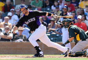 SCOTTSDALE, AZ - MARCH 09:  Michael Cuddyer #3 of the Colorado Rockies follows through on a swing against the Oakland Athletics at Salt River Fields at Talking Stick on March 9, 2012 in Scottsdale, Arizona.  (Photo by Norm Hall/Getty Images)