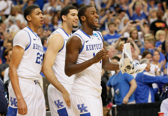 ATLANTA, GA - MARCH 25:  Anthony Davis #23, Eloy Vargas #30 and Michael Kidd-Gilchrist #14 of the Kentucky Wildcats celebrate their 82 to 70 win over the Baylor Bears during the 2012 NCAA Men's Basketball South Regional Final at the Georgia Dome on March