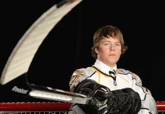 MONTREAL,QC - JUNE 26: Ryan Ellis poses for a portrait after being selected 11th overall by the Nashville Predators during the first round of the 2009 NHL Entry Draft at the Bell Centre on June 26, 2009 in Montreal, Quebec, Canada. (Photo by Jamie Squire/