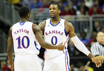 KANSAS CITY, MO - MARCH 09:  Thomas Robinson #0 and Tyshawn Taylor #10 of the Kansas Jayhawks react in the first half against the Baylor Bears during the semifinals of the 2012 Big 12 Men's Basketball Tournament at Sprint Center on March 9, 2012 in Kansas
