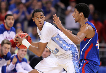 ST LOUIS, MO - MARCH 25:  John Henson #31 of the North Carolina Tar Heels looks to pass as he is defended by Kevin Young #40 of the Kansas Jayhawks during the 2012 NCAA Men's Basketball Midwest Regional Final at Edward Jones Dome on March 25, 2012 in St L