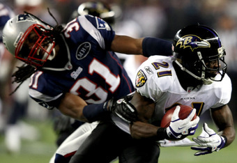 FOXBORO, MA - JANUARY 22:   Lardarius Webb #21 of the Baltimore Ravens runs the ball against Sergio Brown #31 of the New England Patriots during their AFC Championship Game at Gillette Stadium on January 22, 2012 in Foxboro, Massachusetts.  (Photo by Al B
