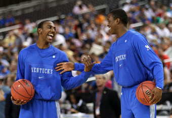 NEW ORLEANS, LA - MARCH 30:  Marquis Teague #25 and Doron Lamb #20 of the Kentucky Wildcats talk during practice prior to the 2012 Final Four of the NCAA Division I Men's Basketball Tournament at the Mercedes-Benz Superdome on March 30, 2012 in New Orlean