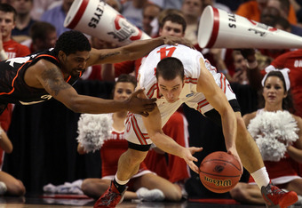 BOSTON, MA - MARCH 22:  Jaquon Parker #44 of the Cincinnati Bearcats fights for the loose ball against Aaron Craft #4 of the Ohio State Buckeyes during their 2012 NCAA Men's Basketball East Regional Semifinal game at TD Garden on March 22, 2012 in Boston,
