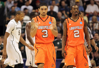 PHOENIX, AZ - MARCH 22:  Peyton Siva #3 and Russ Smith #2 of the Louisville Cardinals react in the second half while takingon the Michigan State Spartans during the 2012 NCAA Men's Basketball West Regional Semifinal game at US Airways Center on March 22,
