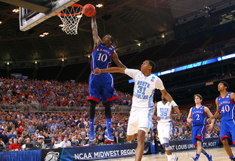 ST LOUIS, MO - MARCH 25:  Tyshawn Taylor #10 of the Kansas Jayhawks dunks in the second half against John Henson #31 of the North Carolina Tar Heels during the 2012 NCAA Men's Basketball Midwest Regional Final at Edward Jones Dome on March 25, 2012 in St