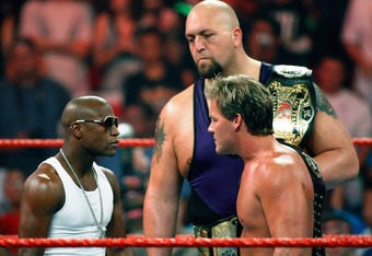 LAS VEGAS - AUGUST 24:  Boxer Floyd Mayweather Jr. (L) stares down wrestlers Chris Jericho and Big Show during the WWE Monday Night Raw show at the Thomas & Mack Center August 24, 2009 in Las Vegas, Nevada. Mayweather was a special guest host during the b