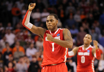 BOSTON, MA - MARCH 24:  Deshaun Thomas #1 and Jared Sullinger #0 of the Ohio State Buckeyes celebrate towards the end of the game against the Syracuse Orange during the 2012 NCAA Men's Basketball East Regional Final at TD Garden on March 24, 2012 in Bosto
