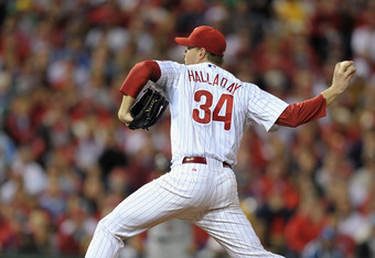 PHILADELPHIA, PA - OCTOBER 07:  Roy Halladay #34 of the Philadelphia Phillies throws a pitch against the St. Louis Cardinals during Game Five of the National League Divisional Series at Citizens Bank Park on October 7, 2011 in Philadelphia, Pennsylvania.