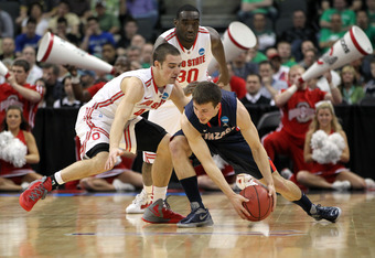 PITTSBURGH, PA - MARCH 17:  Kevin Pangos #4 of the Gonzaga Bulldogs looks to control the ball in the first half against Aaron Craft #4 and Evan Ravenel #30 of the Ohio State Buckeyes during the third round of the 2012 NCAA Men's Basketball Tournament at C