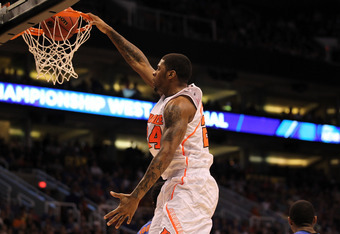 PHOENIX, AZ - MARCH 24:  Chane Behanan #24 of the Louisville Cardinals dunks the ball in the first half against the Florida Gators during the 2012 NCAA Men's Basketball West Regional Final at US Airways Center on March 24, 2012 in Phoenix, Arizona.  (Phot