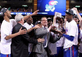 ST LOUIS, MO - MARCH 25: (L-R) Travis Releford #24, Jamari Traylor, head coach Bill Self, Tyshawn Taylor #10 and Thomas Robinson #0 of the Kansas Jayhawks celebrate with the midwest regional championship trophy after they won 80-67 against the North Carol