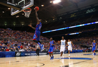 ST LOUIS, MO - MARCH 25:  Tyshawn Taylor #10 of the Kansas Jayhawks drives for a shot attempt in the second half against the North Carolina Tar Heels during the 2012 NCAA Men's Basketball Midwest Regional Final at Edward Jones Dome on March 25, 2012 in St