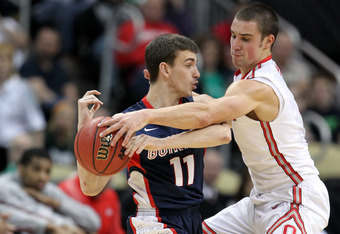 PITTSBURGH, PA - MARCH 17:  David Stockton #11 of the Gonzaga Bulldogs looks to pass the ball in the first half as he is defended by Aaron Craft #4 of the Ohio State Buckeyes during the third round of the 2012 NCAA Men's Basketball Tournament at Consol En