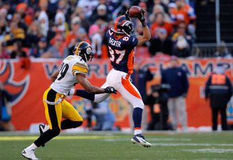 DENVER, CO - JANUARY 08:  Eric Decker #87 of the Denver Broncos catches a pass against Ryan Mundy #29 of the Pittsburgh Steelers during the AFC Wild Card Playoff game at Sports Authority Field at Mile High on January 8, 2012 in Denver, Colorado.  (Photo b