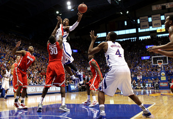 LAWRENCE, KS - DECEMBER 10:  Thomas Robinson #0 of the Kansas Jayhawks passes to Justin Wesley #4 during the game against the Ohio State Buckeyes on December 10, 2011 at Allen Fieldhouse in Lawrence, Kansas.  (Photo by Jamie Squire/Getty Images)