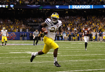 NEW ORLEANS, LA - JANUARY 03:  Junior Hemingway #21 of the Michigan Wolverines catches a 45-yard touchdown reception in the second quarter against the Virginia Tech Hokies during the Allstate Sugar Bowl at Mercedes-Benz Superdome on January 3, 2012 in New
