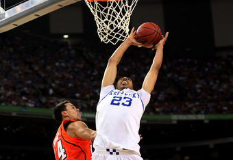 NEW ORLEANS, LA - MARCH 31:  Anthony Davis #23 of the Kentucky Wildcats goes up for a dunk over Kyle Kuric #14 of the Louisville Cardinals during the National Semifinal game of the 2012 NCAA Division I Men's Basketball Championship at the Mercedes-Benz Su