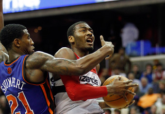 WASHINGTON, DC - JANUARY 06: Iman Shumpert #21 of the New York Knicks guards John Wall #2 of the Washington Wizards as he drives to the basket during the second half at Verizon Center on January 6, 2012 in Washington, DC.  NOTE TO USER: User expressly ack
