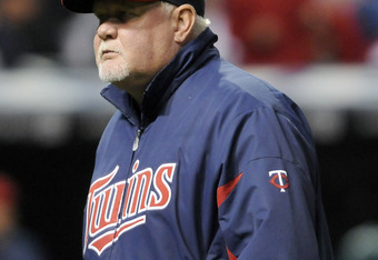 CLEVELAND, OH - SEPTEMBER 24: Manager Ron Gardenhire #35 of the Minnesota Twins returns to the dugout after a pitching change during the seventh inning against the Cleveland Indians at Progressive Field on September 24, 2011 in Cleveland, Ohio. (Photo by