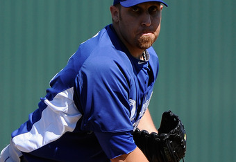 TEMPE, AZ - MARCH 12:  Starting pitcher Aaron Harang #44 of the Los Angeles Dodgers throws a pitch during a spring training baseball game against of the Los Angeles Angels of Anaheim at Tempe Diablo Stadium on March 12, 2012 in Tempe, Arizona.  (Photo by