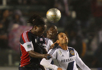 CARSON, CA - MARCH 31:  Shalrie Joseph #21 of the New England Revolution and Marcelo Sarvas #8 of the Los Angeles Galaxy vie for a high ball during the MLS match at The Home Depot Center on March 31, 2012 in Carson, California.  (Photo by Joe Scarnici/Get