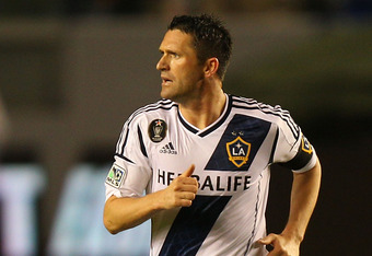 CARSON, CA - MARCH 31:  Robbie Keane #7 of the New England Revolution moves the ball up the field during the MLS match at The Home Depot Center on March 31, 2012 in Carson, California.  (Photo by Joe Scarnici/Getty Images)