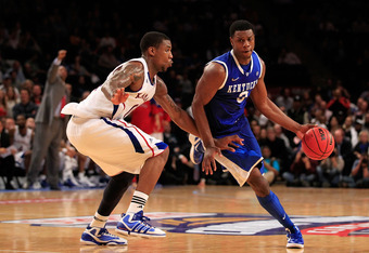 NEW YORK - NOVEMBER 15:  Terrence Jones #3 of the Kentucky Wildcats drives the ball against Thomas Robinson #0 of the Kansas Jayhawks during the 2011 State Farms Champions Classic at Madison Square Garden on November 15, 2011 in New York City.  (Photo by