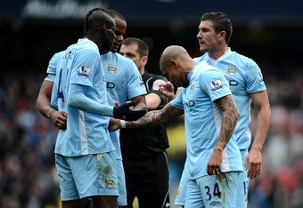 MANCHESTER, ENGLAND - MARCH 31:  Mario Balotelli of Manchester City argues with team mate Aleksandar Kolarov (R) over a free kick during the Barclays Premier League match between Manchester City and Sunderland at the Etihad Stadium on March 31, 2012 in Ma