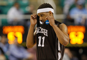 GREENSBORO, NC - MARCH 18:  Mackey McKnight #11 of the Lehigh Mountain Hawks reacts in the second half while taking on the Xavier Musketeers during the third round of the 2012 NCAA Men's Basketball Tournament at Greensboro Coliseum on March 18, 2012 in Gr