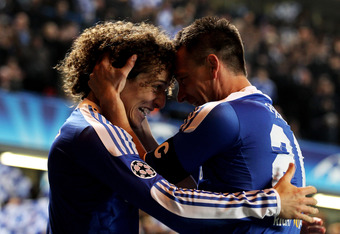 LONDON, ENGLAND - MARCH 14:  John Terry (R)of Chelsea celebrates with teammate David Luiz (L) after scoring his team's second goal during the UEFA Champions League round of 16 second leg match between Chelsea FC and SSC Napoli Stamford Bridge on March 14,